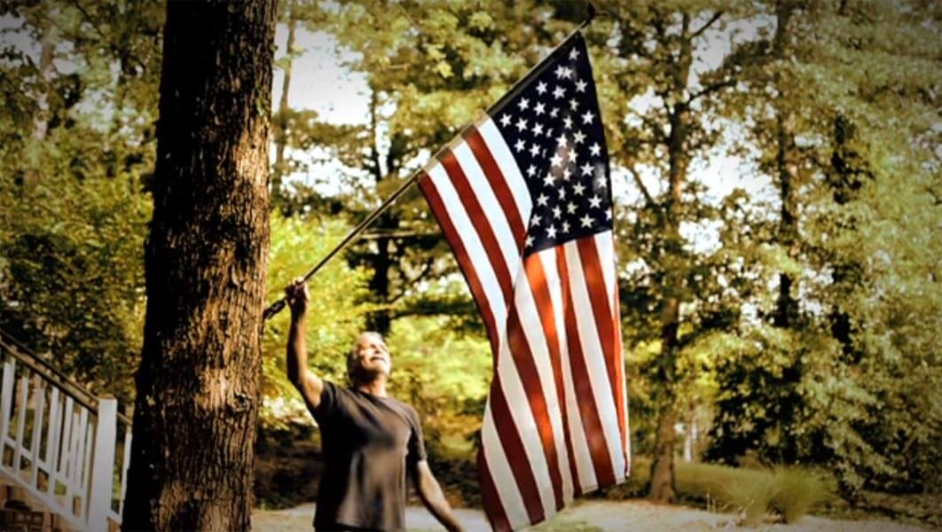 Why do we put up the American Flag?