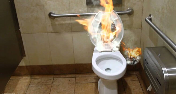Stupid friend sets his buddy on fire while in the bathroom
